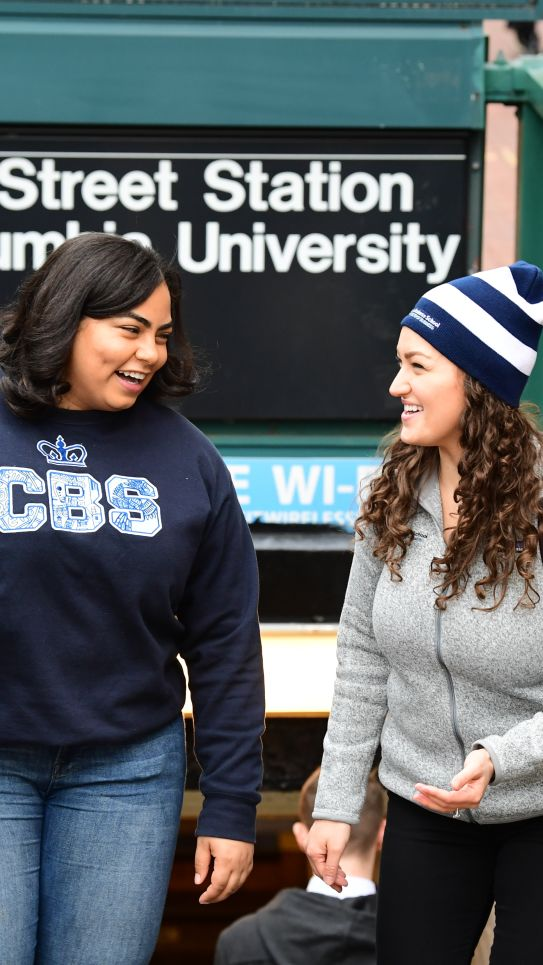 Two students exit the 116th street station