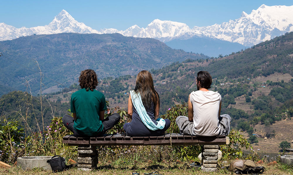 Meditation with the panoramic view of mountain ranges