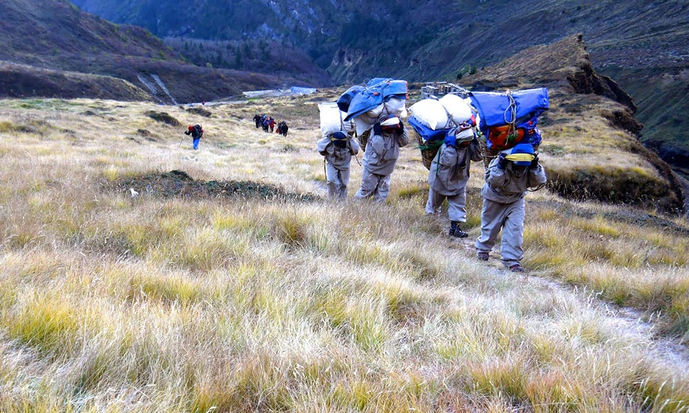 Porters ascending towards Dhampus peak