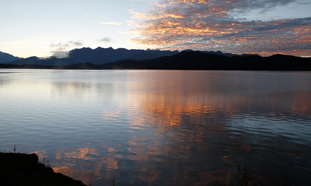 Reflection of clouds on Rara Lake during Sunset