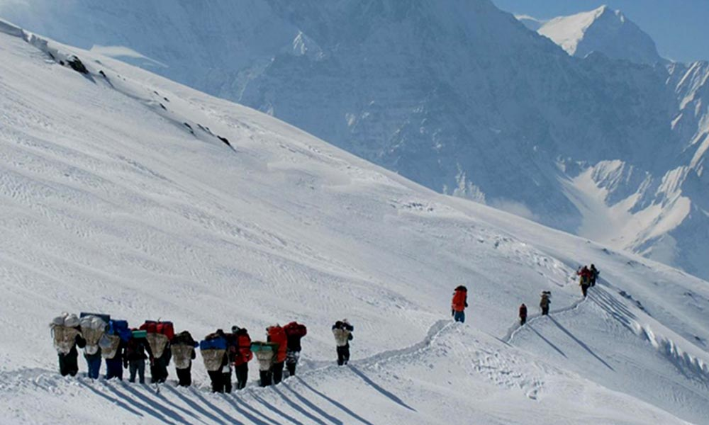Porters on the ascent of Thapa/Dhampus Peak
