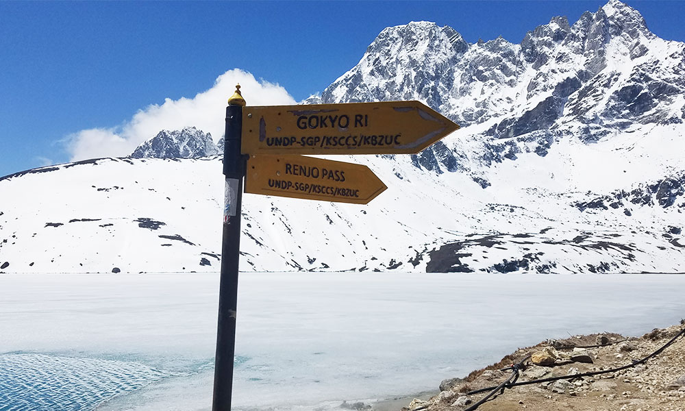 Arrow sign with direction for Gokyo Ri and Renjo La Pass