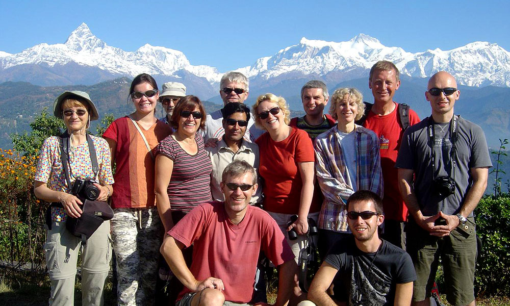 Group photo of trekkers with Annapurna Ranges in the backdrop
