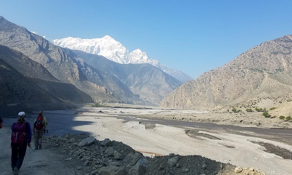 Tourists walking on the bank of Kali Gandaki