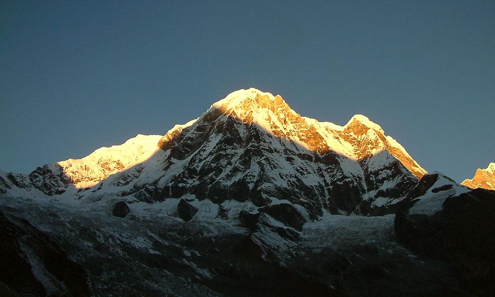 Sunrise at Annapurna South from Annapurna South Base Camp