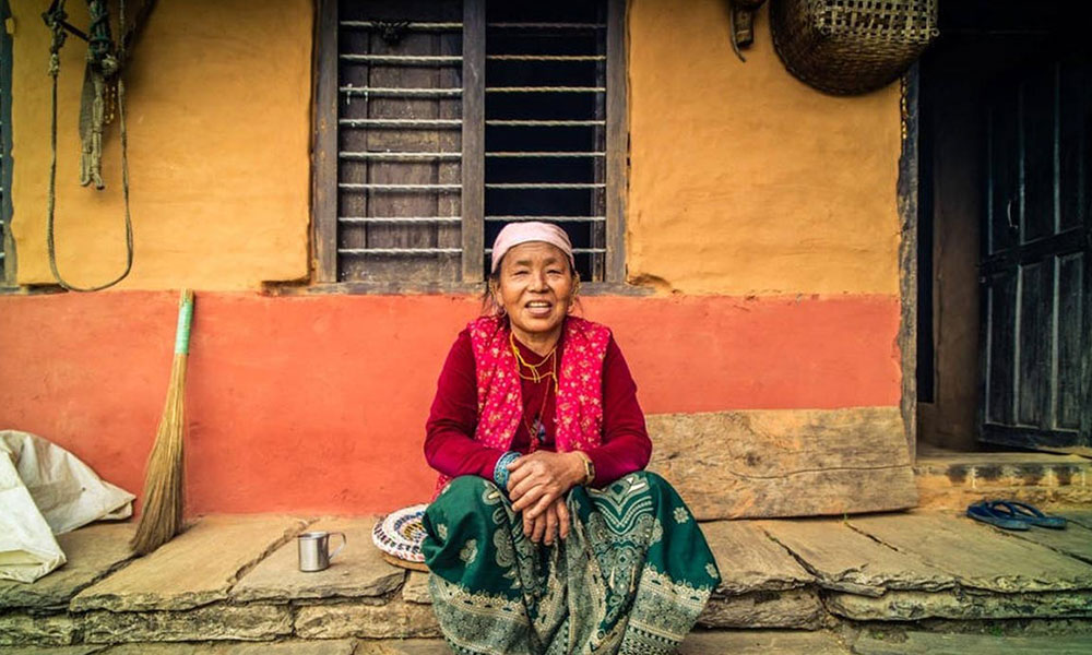 An elderly woman in a local house