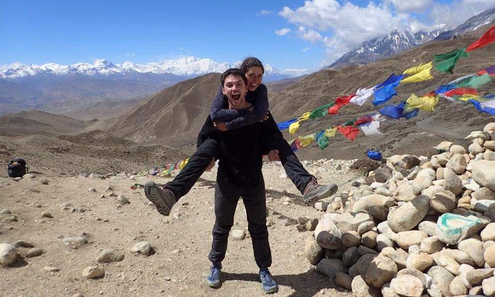 A couple celebrating their joyous ascent