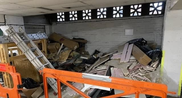 Commercial property with piles of unwanted wood