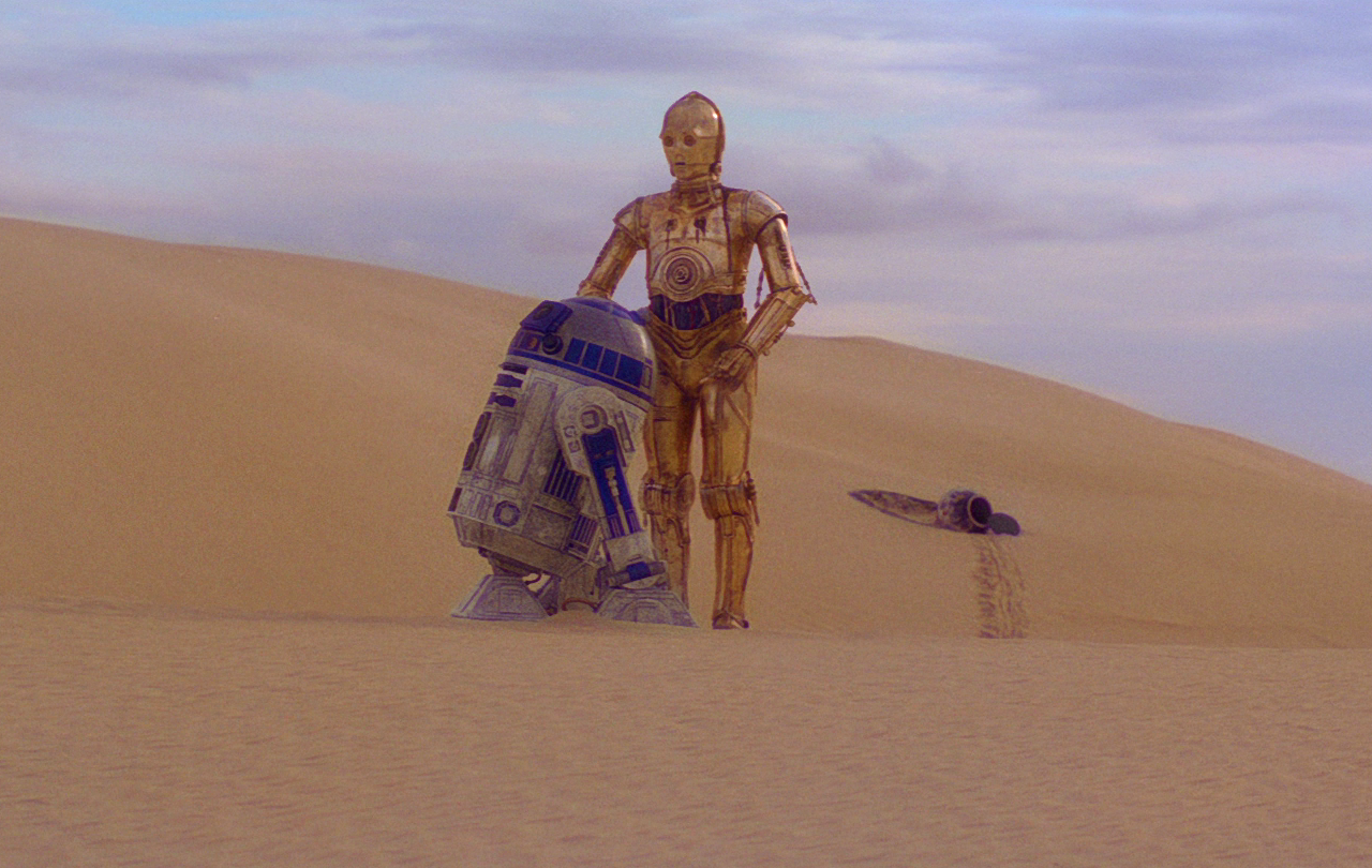 R2-D2 and C3-P0 argue in the desert over the future direction of their mission