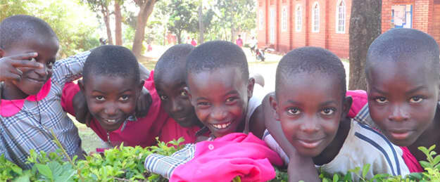 African children pose for a photo in their school uniforms