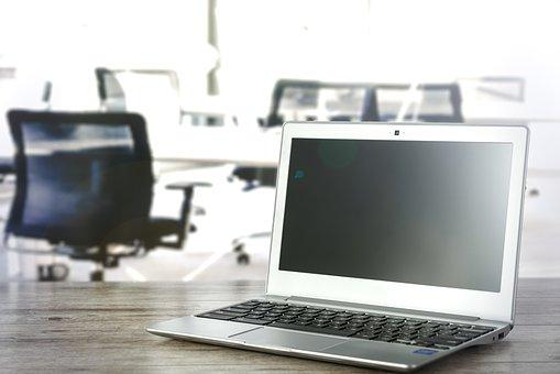 an open laptop on a desk in an office space