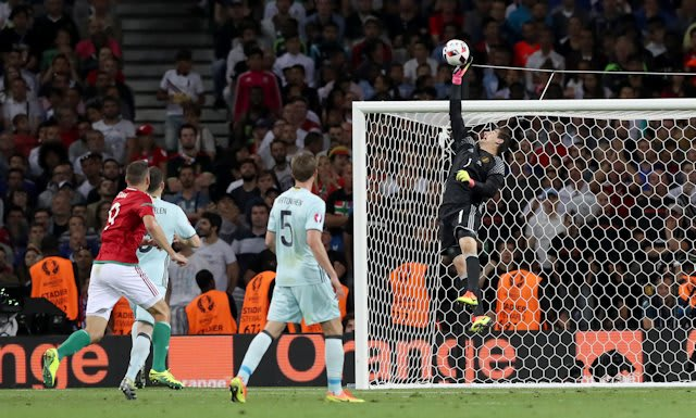 Courtois makes a save against Hungary in the last 16 of Euro 2016