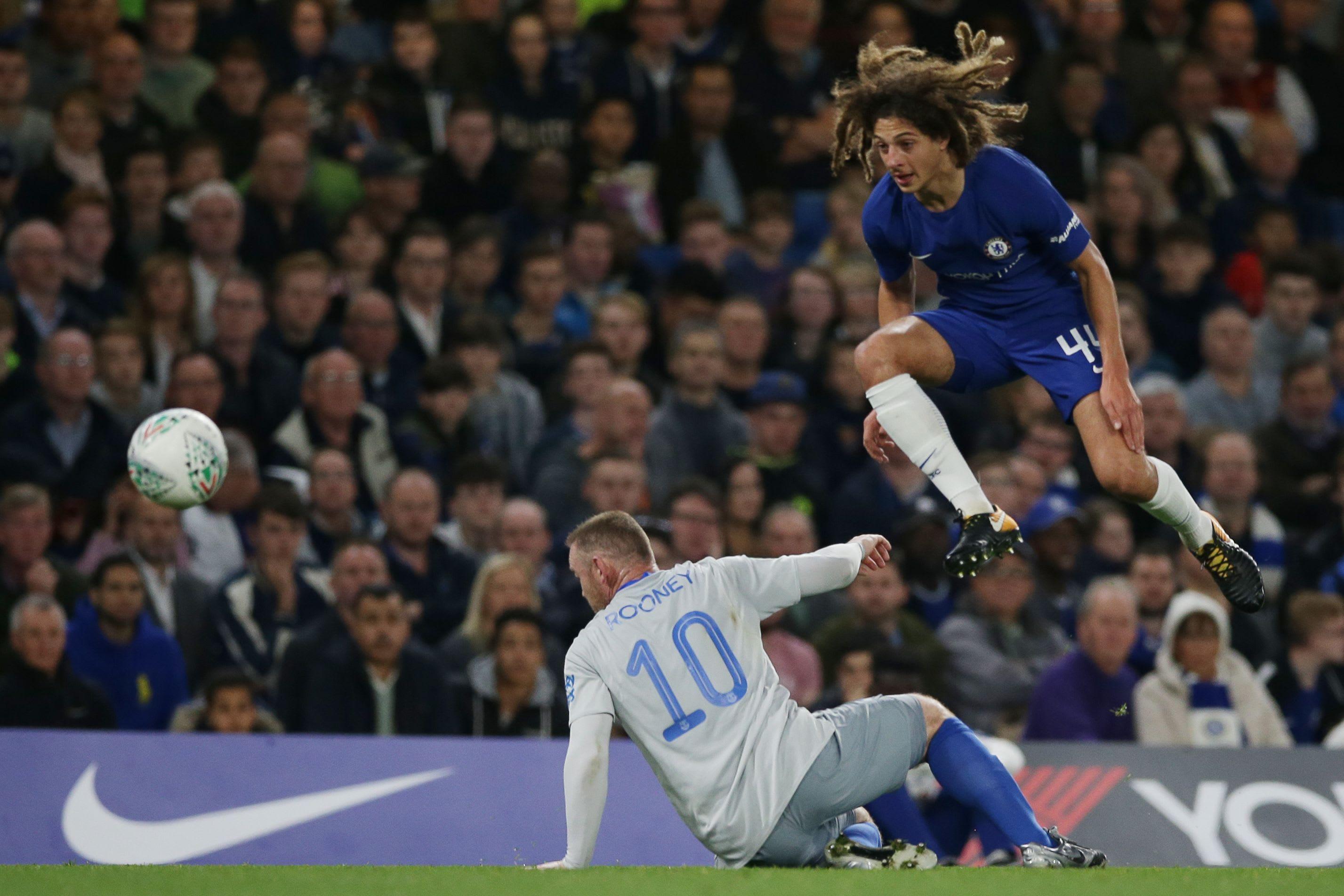 Ethan Ampadu gets the ball over Everton's Wayne Rooney