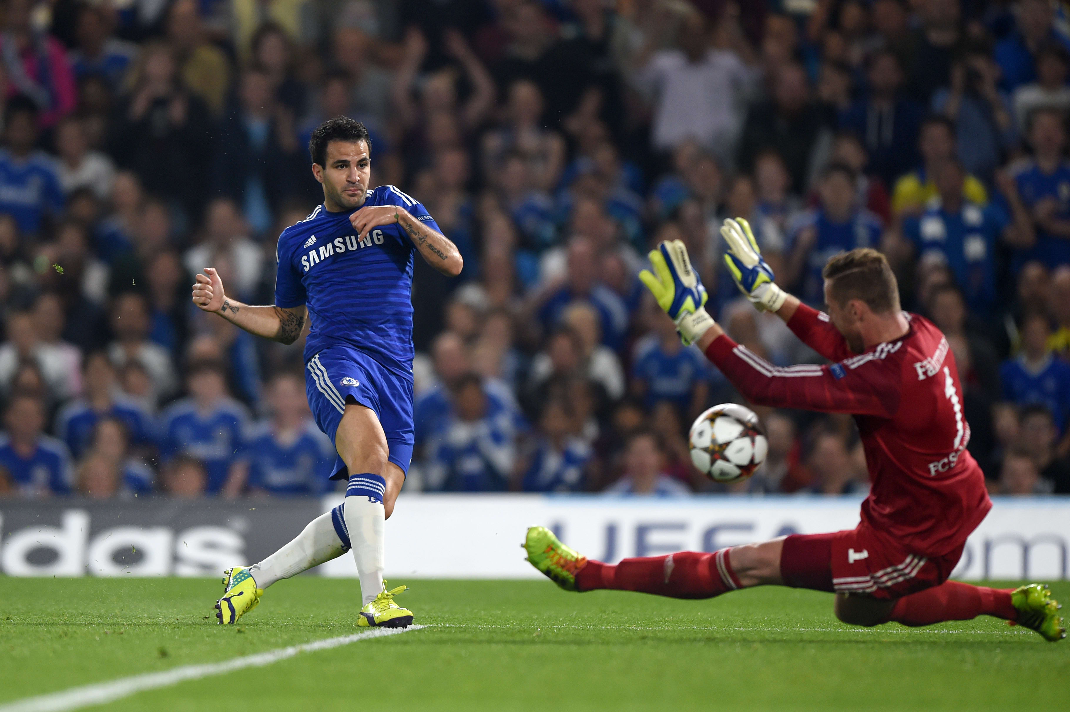 Fabregas beats the Schalke keeper for his first Chelsea goal.