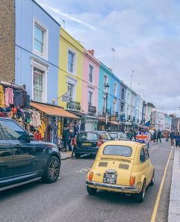 {scenes from Portobello Market} the sound of vendors boasting their trinkets are worth the price, the smells of crepes and coffee, the sidewalks full of tourists and shoppers alike and the colorful views that make Notting Hill truly remarkable.
