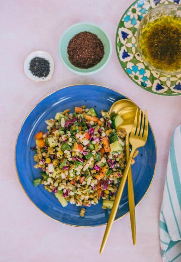 Mediterranean Pearl Couscous Salad with Sumac Dressing Cover Image