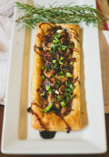 Caramelized Onion and Chanterelle Tart with Balsamic Guinness Glaze Cover Image