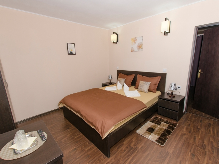 Double bed in the first room of the ground floor family suite