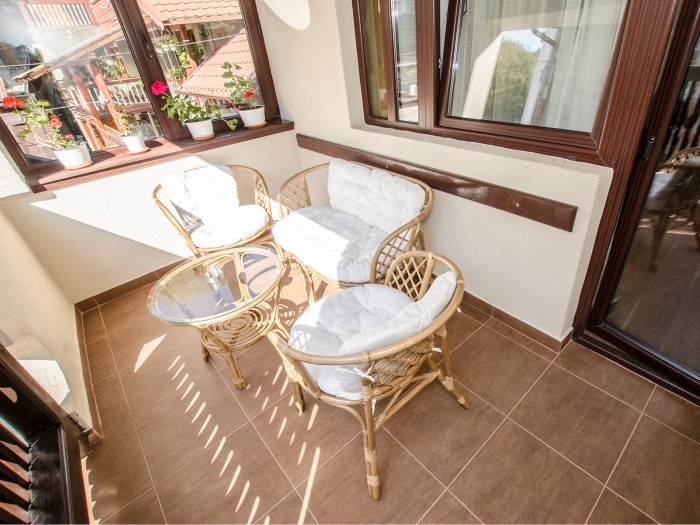 Top-down view of the first floor double room balcony, at Chez Marcel Sinaia