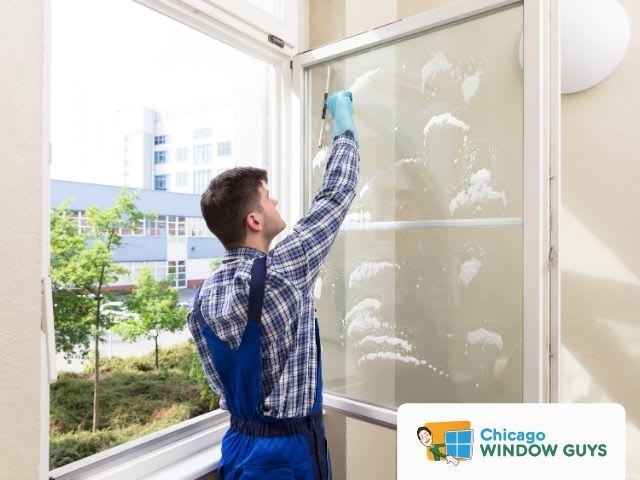 Person cleaning Windows