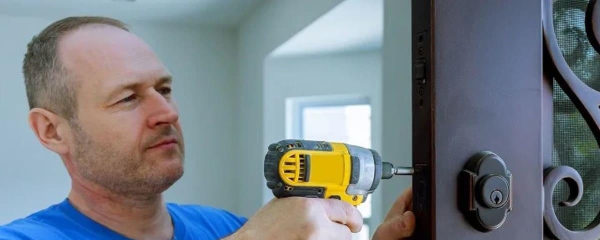 Man Fixing Door