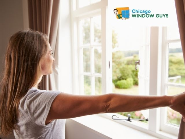 Women opening curtains of windows