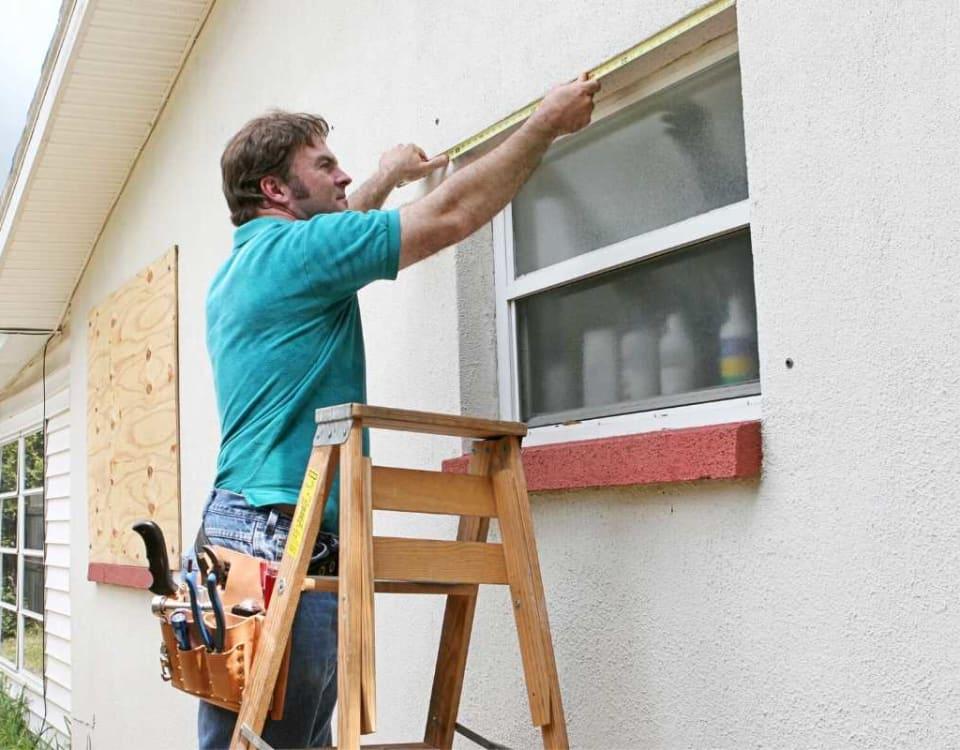 Man measuring standard window size
