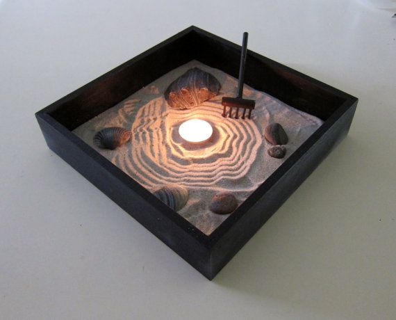 miniature zen garden with candle holder