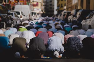 Muslims kneeling and praying