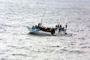 Refugees packed onto a boat