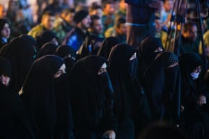 Niqab clad women sitting together