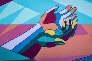 Painted mural of colourful hands