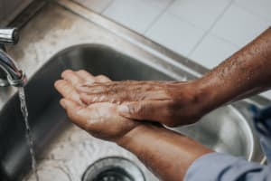 Hands being washed with soap