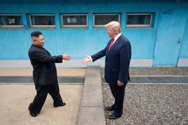 President Donald J. Trump shakes hands with Chairman of the Workers' Party of Korea Kim Jong Un Sunday, June 30, 2019, as the two leaders meet at the Korean Demilitarized Zone