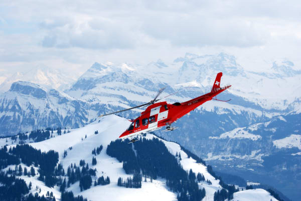 Rega plane flying over the Alps