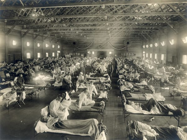 Description: Beds with patients in an emergency hospital in Camp Funston, Kansas, in the midst of the influenza epidemic.
