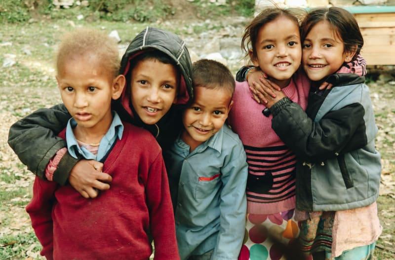 Refugee children smiling for camera