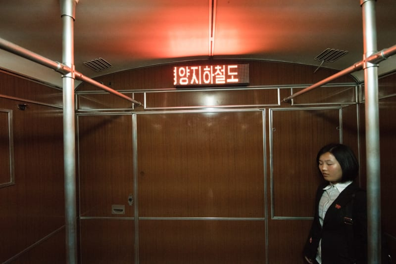 A North Korean standing on the metro in Pyongyang