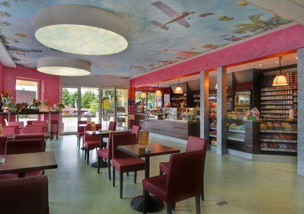 Spanndecke mit Motiv mit Beleuchtung im Gewerbe Restaurant