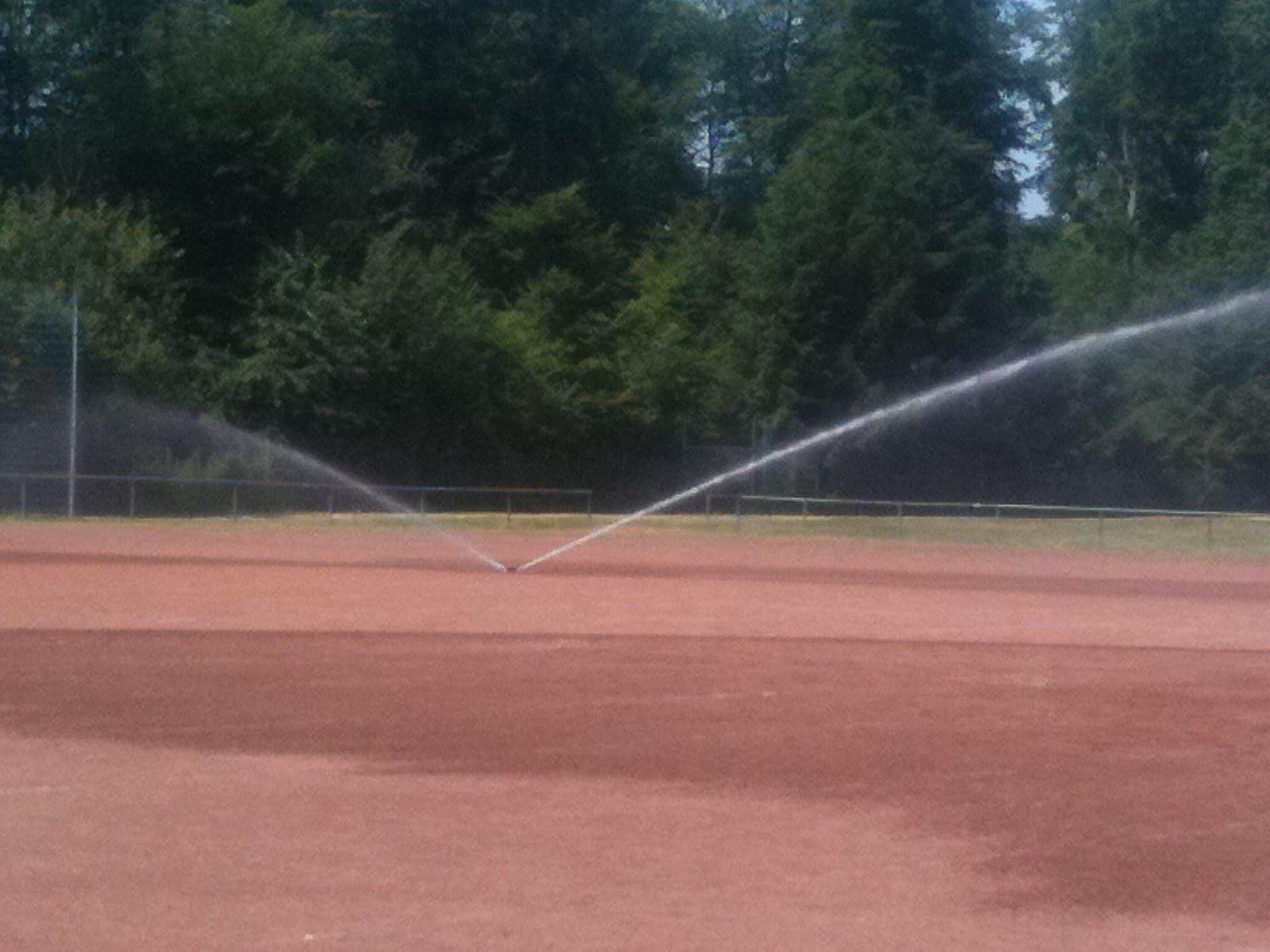 Tennisplatz Bewässerung Optirain