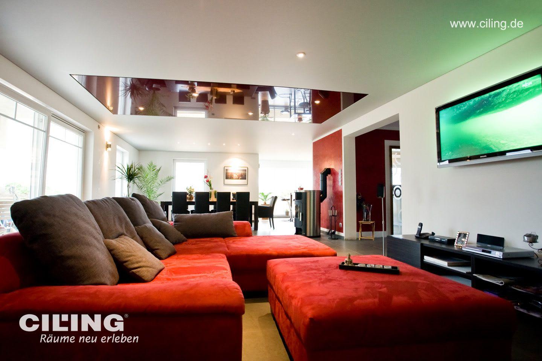 Galerie Wohnzimmer weiße Spanndecke rotes Sofa