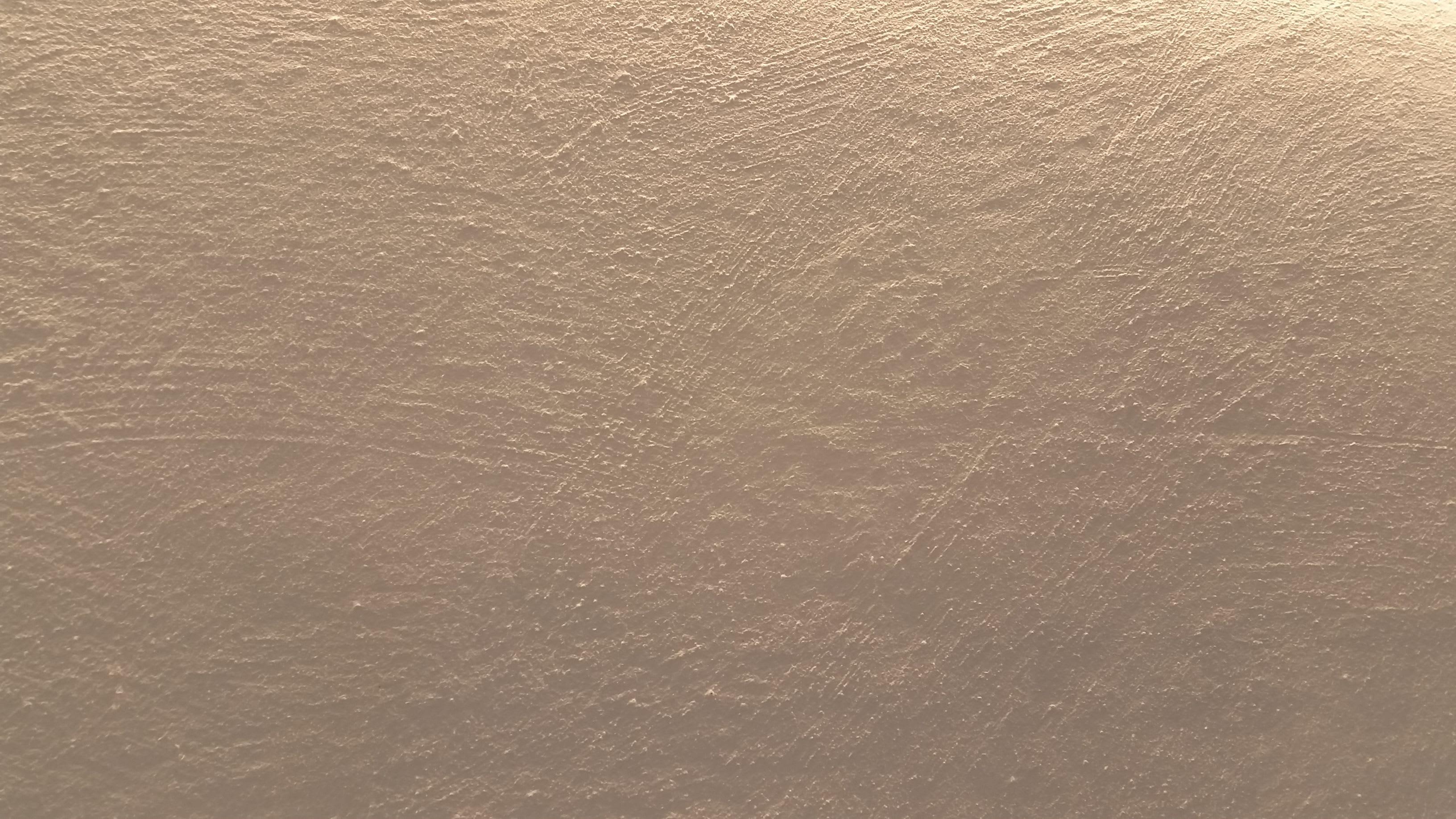 Steinimitation raue weiße Wand