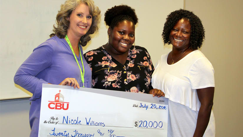Accounting Career Awareness and Diversity Program participant receives check