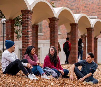 4 students outdoors on the CBU campus