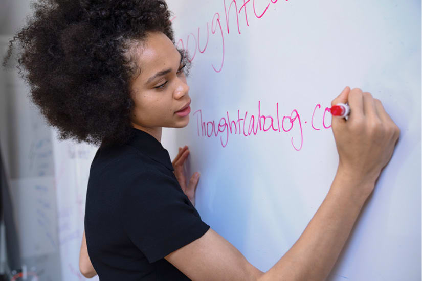 Student writing on whiteboard