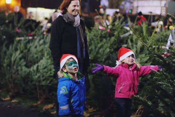 Mother and children choosing a Christmas tree