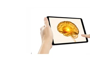 tablet with a 3D brain illuminated at the core
