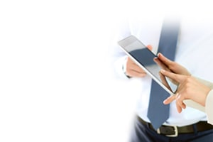 clinical research professionals review information on a tablet
