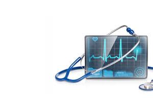 tablet with ekg on display along woth a stethoscope
