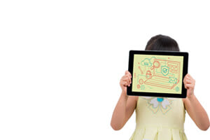 Child student holding tablet in front of face